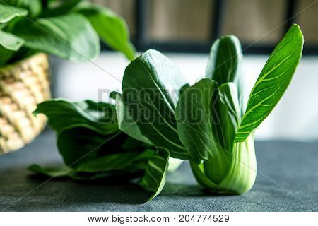close up Fresh baby green bok choy on black background overhead or top view shot