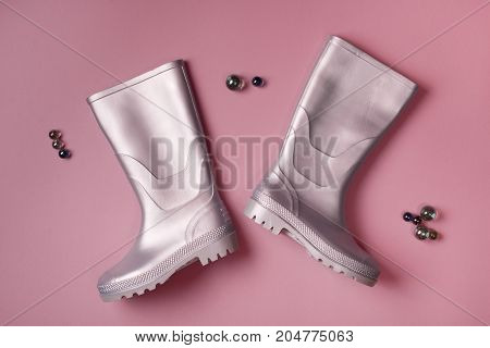 Gumboots And Glass Balls On Pink