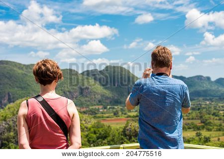 Woman And Man In The Background Of The Valley Of Vinales, Pinar Del Rio, Cuba. Copy Space For Text.