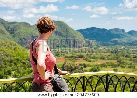 Woman On The Background Of Vinales Valley, Pinar Del Rio, Cuba. Copy Space For Text.