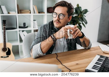 Thoughtful Man With Cup Of Coffee