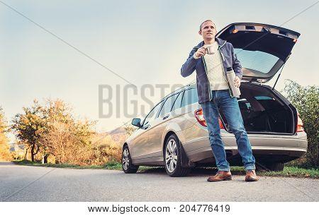 Driver have a tea/coffee break on roadside