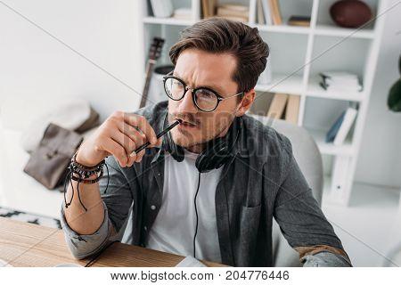 Man With Headphones Looking Away