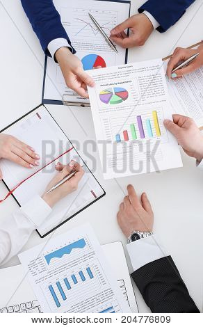 Group Of People Discuss Plan At Workplace Closeup