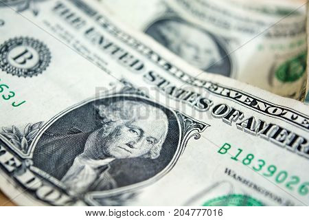 US one dollar bill closeup. Blurred one usd banknote. George Washington portrait. United states money.