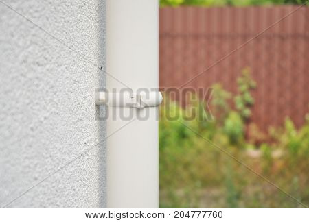 Close up on rain gutter downspout pipe holder