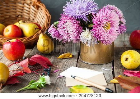 Thanksgiving Background With Seasonal Fruits, Flowers, Greeting Card And Envelope On A Rustic Wooden