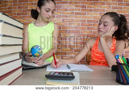 Two young attractive student Girls studying lessons. Thoughts education creativity concept