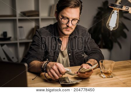 Handsome Man Counting Cash