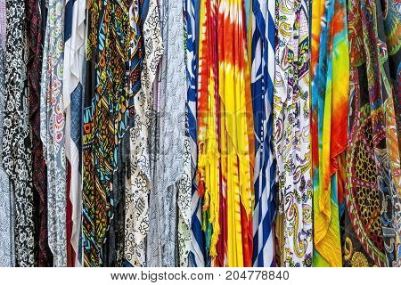 Colorful textile hanging in a street shawl shop.