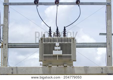 The transformer is located on a cementitone pole.