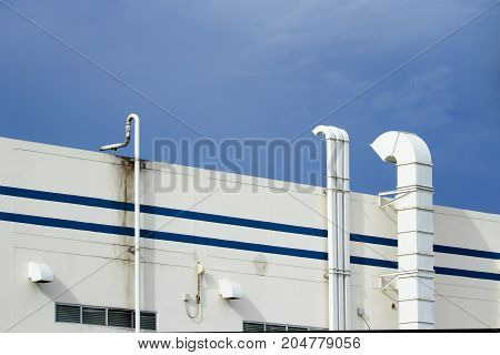 Steel air ducts white outside the building with blue sky