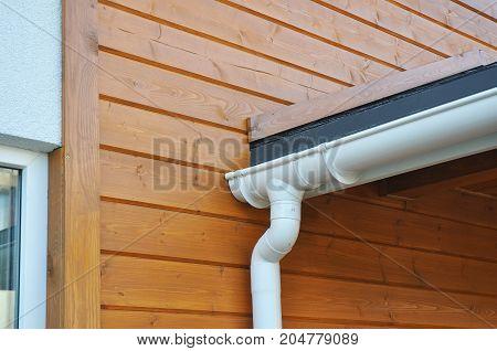 Closeup of problem areas for white rain gutter waterproofing. Roof gutter waterproofing. House Rain gutter repair