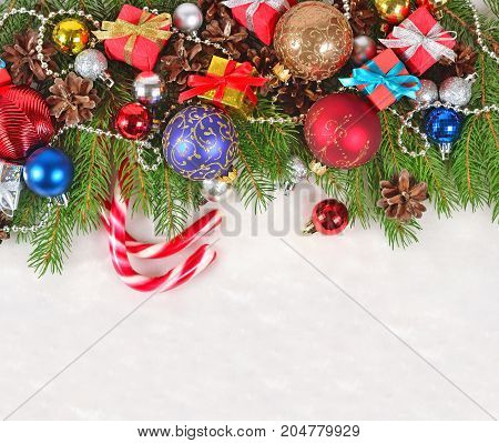 Christmas Decorations On A Spruce Branch On A White