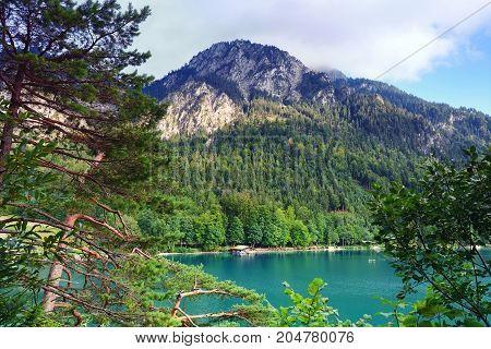 Beautiful View Of The Emerald Alpine Lake. Mountain Lake In The
