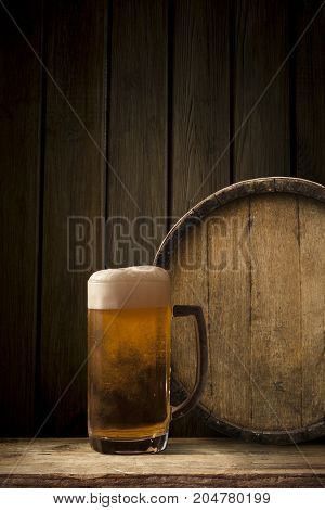 background of barrel and worn old table of wood.