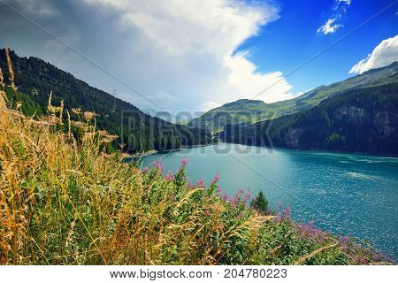 Beautiful View Of The Emerald Alpine Lake. Dramatic And Picturesque Scene. Mountain Lake In The Back
