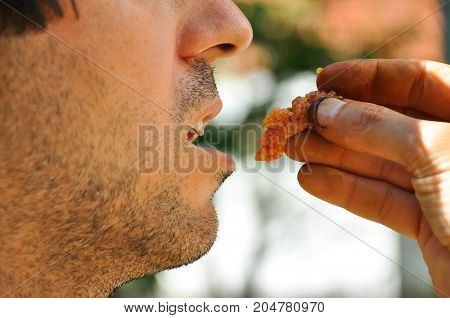 Man eating raw caviar, Man eating raw fish eggs, Man survive in nature,