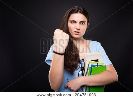 Angry Young Girl Showing Her Fist