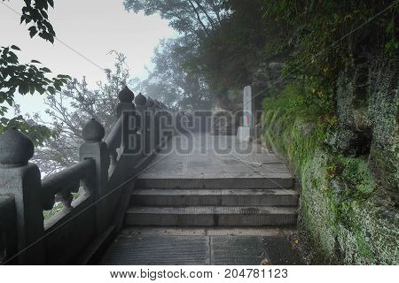 The Wudang MountainsHubei China. Many Taoist monasteries to be found thereIt's world heritate and famous in one of China. This here have a good weather somethime it a lot of the fog. Many stairs in there.