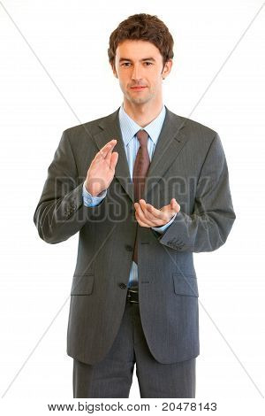 Young modern businessman cheerfully applauding isolated on white