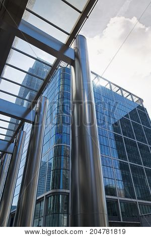 London England - August 13 2017: Canary Wharf  Modern Architecture with glass and steel arch.