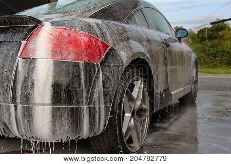 Car detailing : Car Washing with Foam Shampoo.