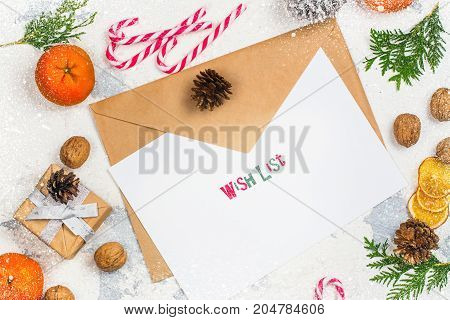 Envelope with paper ready for writting a letter to Santa Claus. Copy space
