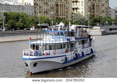 Moscow Russia - July 20 2017: Modern white pleasure boat sails along the Moscow River.