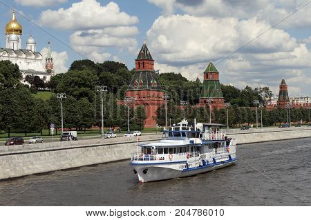 Moscow Russia - July 20 2017: Modern Pleasure boat sails along the river near the Moscow Kremlin.