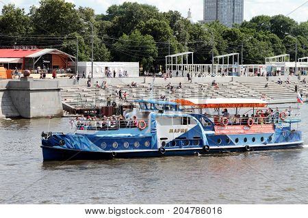 Moscow Russia - July 20 2017: Blue pleasure boat sails along the Moscow River.