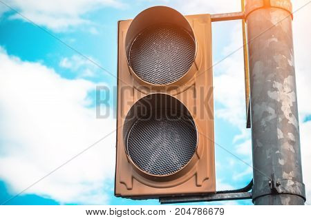 Not Working Traffic Light With A Pedestrian Crossing Against The Sky
