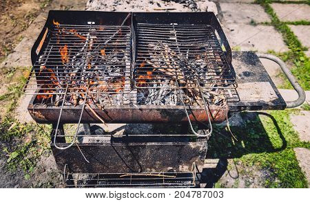 Burning And Preheating Old Rusty Barbecue Grill Cleaning Dirty Grid.