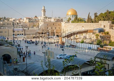 JERUSALEM, ISRAEL. September 15, 2017. The general view of the Western Wall (Wailing wall) and the Temple Mount with the golden dome - Dome of the Rock. Jewish, Muslim and Christian holy sites.