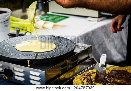 Making Of Crepes Pancakes In Open Market Festival Fair.