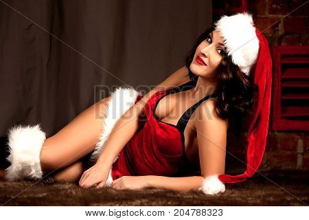 Beautiful Brunette Sexy Santa Clause In Elegant Panties, Hat And Bra. Fashion Portrait Of Model Girl