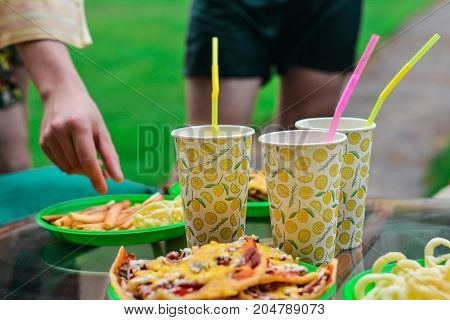 Party food, people on the party having drinks