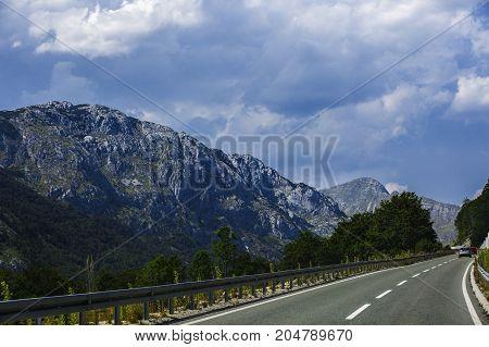 A Beautiful mountain road through Montenegro .