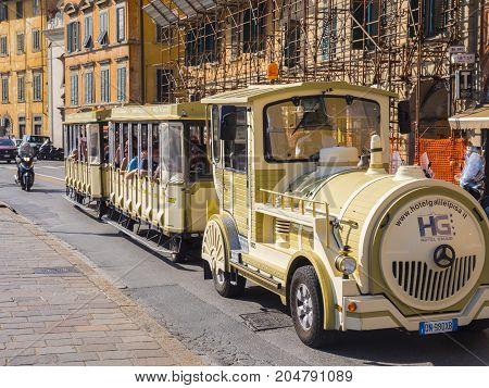 Sightseeing tram in the city of Pisa - PISA TUSCANY ITALY - SEPTEMBER 13, 2017