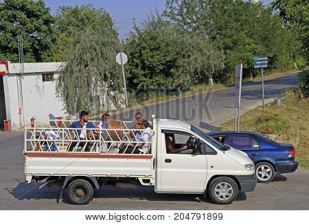 Musician Are Riding In Body Of Small Truck