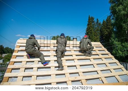 Workers on a renovation roof under construction.