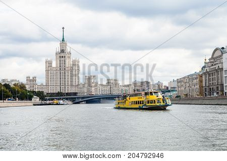 Ship On Moskva River And High-rise Building