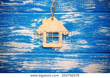 The symbol hanging on blue wooden background