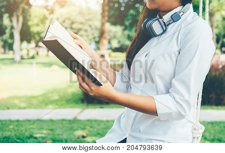 Young business female while she is relaxing in coffee shop in the fresh air