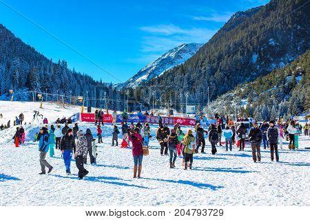 Bansko, Bulgaria - December 12, 2015: Ski resort Bansko, ski slope with people walking and skiing