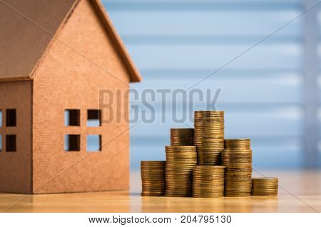 Saving money to buy a new home of its own money in the piggy bank. Lowest cost and tax.