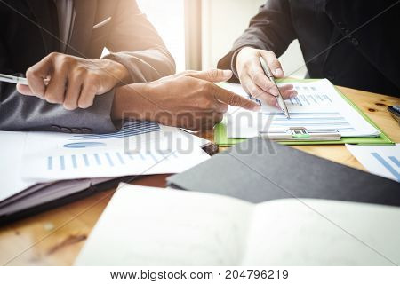 Co-workers are consultants on business documents, tax, transactions and business combinations after a bankrupt merger with a newly founded company.