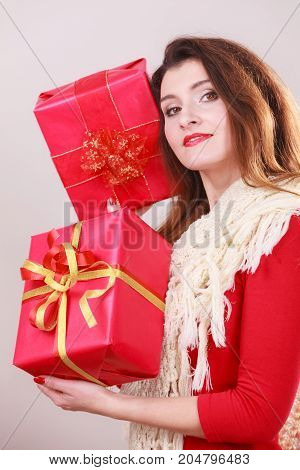 Woman Holds Red Christmas Gift Boxes