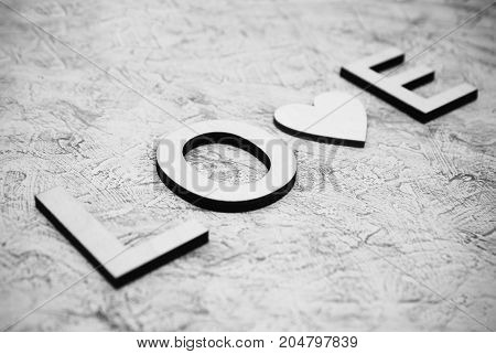 Wooden love letters black and white photo