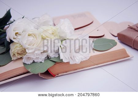 Craft gift box on old shabby wooden table. Still life with lisianthus.